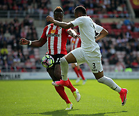 (L-R) Lamine Kone of Sunderland is challenged by Jordan Ayew of Swansea City during the Premier League match between Sunderland and Swansea City at the Stadium of Light, Sunderland, England, UK. Saturday 13 May 2017