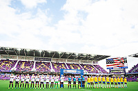 ORLANDO CITY, FL - FEBRUARY 21: USWNT standing for the National Anthem before a game between Brazil and USWNT at Exploria Stadium on February 21, 2021 in Orlando City, Florida.
