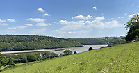 BNPS.co.uk (01202 558833)<br /> Pic: LillicrapChilcott/BNPS<br /> <br /> Pictured: The view.<br /> <br /> A sprawling waterfront estate that has been in the same family for half a century is on the market for £2.25m.<br /> <br /> Bellscat Farmhouse is a pretty Grade II listed home with beautiful far-reaching views over Fowey River in Cornwall.<br /> <br /> The grand four-bedroom home looks a far cry from a typical farmhouse and is believed to have been two farm cottages that were converted into one home.<br /> <br /> There is also a separate two-bedroom barn and the properties sit in 37 acres of undulating land, creating a private and scenic estate.