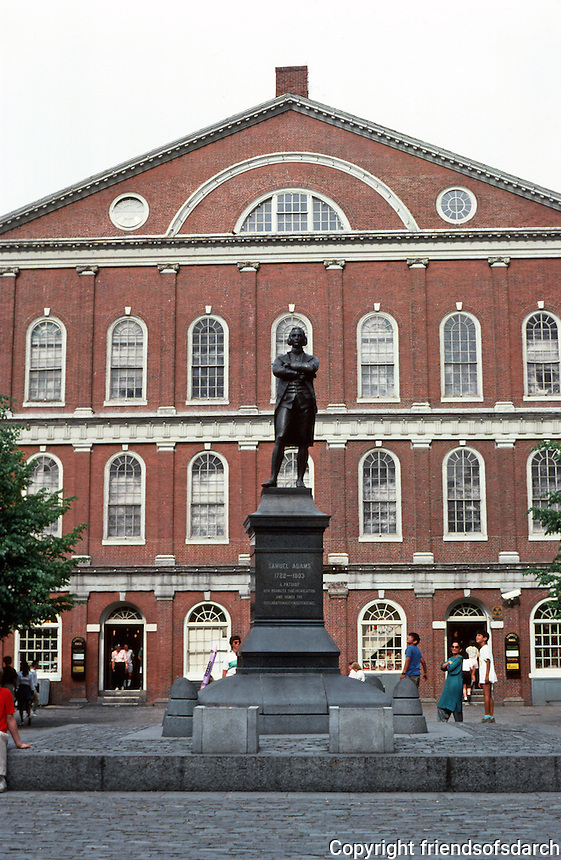 Boston:  Faneuil Hall, West Elevation. Artist John Smibert,1740-42;  expanded by Charles Bullfinch, 1805-06.  Samuel Adams statue by Anne Whitney, 1776.  Original design was a country market.  Photo '88.
