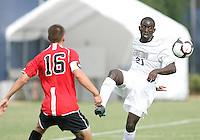 Henry Tembon #21 of Georgetown University sends over a pass past Santiago Bedoya #16 of Northeastern University during an NCAA match at North Kehoe Field, Georgetown University on September 3 2010 in Washington D.C. Georgetown won 2-1 AET.