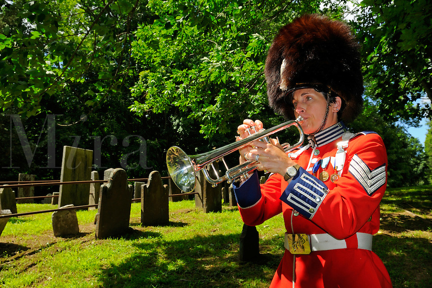 "Sergeant Lisa Pettinicchi, Band Conductor of the Second Company, Governor's Foot Guard, New Haven, Connecticut, plays Taps in Old Norwichtown Cemetery at the gravesite ceremony of Samuel Huntington in celebration of his  birthday. Arguably the first president of the USA,  Huntington was president of Congress when the nation was first designated ""United States"" in the Articles of Confederation."