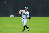 Clinton LumberKings outfielder Keegan McGovern (12) warms up in the outfield prior to a Midwest League game against the Lansing Lugnuts on July 15, 2018 at Ashford University Field in Clinton, Iowa. Clinton defeated Lansing 6-2. (Brad Krause/Four Seam Images)