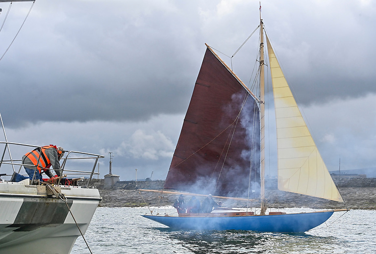 Gun smoke for Estelle as she is greeted back to Dun Laoghaire by a 21 gun salute by Dublin Bay Sailing Club