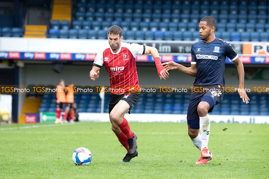 Matty Blair, Cheltenham Town is pushed wide by Timothee Dieng, Southend United during Southend United vs Cheltenham Town, Sky Bet EFL League 2 Football at Roots Hall on 17th October 2020