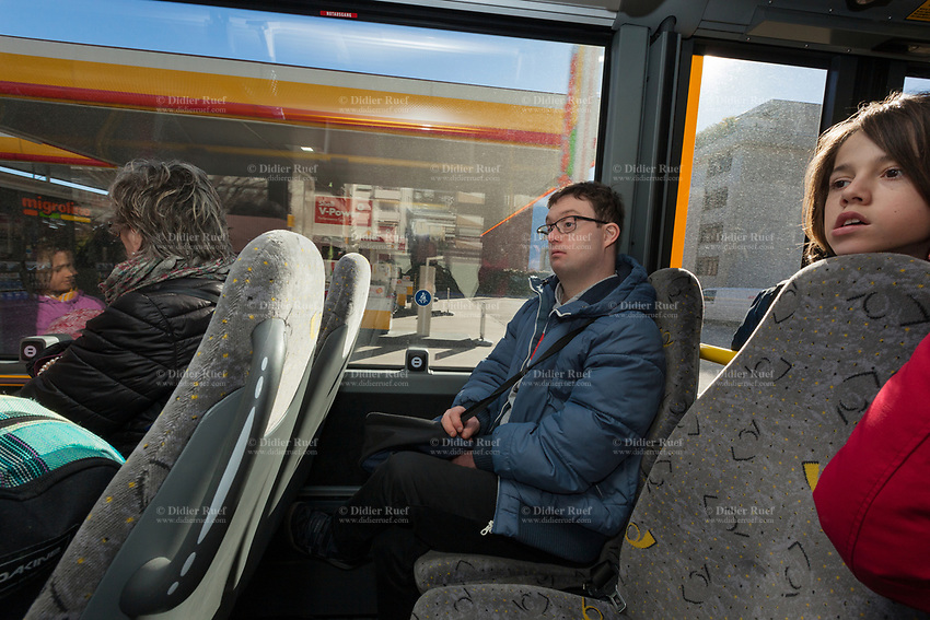 Switzerland. Canton Ticino. Locarno. Simone Lunardi (C) seats in a public bus and travels back home. He is a dancing member of MOPS_DanceSyndrome which is an independent Swiss artistic, cultural and social organisation operating in the field of contemporary dance and disability. It is composed only of Down dancers. Down syndrome (DS or DNS), also known as trisomy 21, is a genetic disorder caused by the presence of all or part of a third copy of chromosome 21 It is usually associated with physical growth delays, mild to moderate intellectual disability, and characteristic facial features. 31.01.2020 © 2020 Didier Ruef