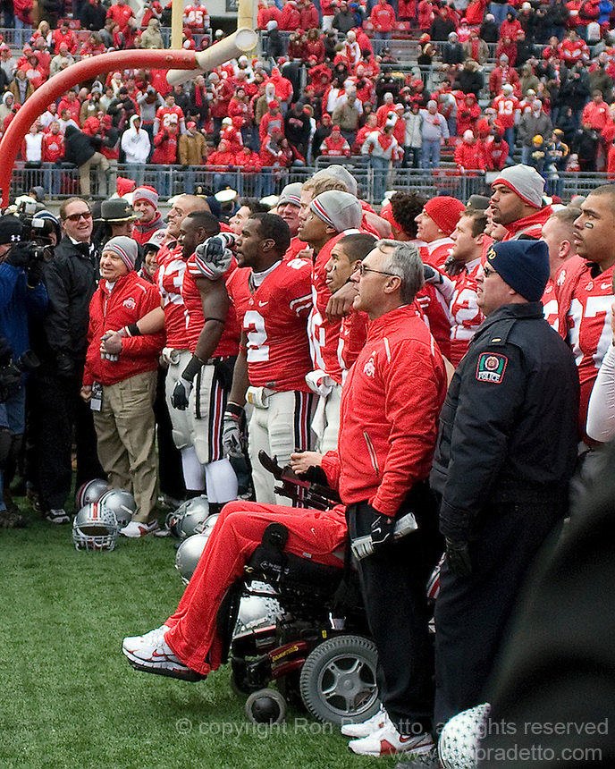 November 22, 2008. Ohio State head coach Jim Tressel (far right in red jacket) and members of the team sing Carmen Ohio after the game. The Ohio State Buckeyes defeated the Michigan Wolverines 42-7 on November 22, 2008 at Ohio Stadium, Columbus, Ohio.