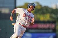 Third baseman Rafael Devers (13) of the Greenville Drive rounds third base, heading for home in a game against the Augusta GreenJackets on Thursday, July 16, 2015, at Fluor Field at the West End in Greenville, South Carolina. Devers is the No. 6 prospect of the Boston Red Sox, according to Baseball A