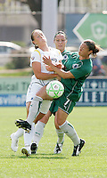 Brittiny Bock (white) collides with Lisa Stoia...Saint Louis Athletica and LA Sol, played to a 0-0 tie at Robert Hermann Stadium in St Louis, MO. April 25 2009.