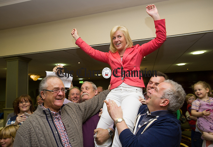 Independent candidate Ann Norton celebrates her election victory with supporters during the election count at The West county Hotel, Ennis. Photograph by John Kelly.