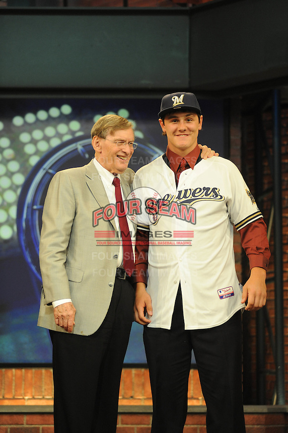 Catcher Clint Coulter (Union H.S.) the number twentyseventh overall pick to the Milwaukee Brewers with MLB Commissioner Bud Selig during the MLB Draft on Monday June 04,2012 at Studio 42 in Secaucus, NJ.   (Tomasso DeRosa/ Four Seam Images)
