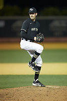 Wake Forest Demon Deacons relief pitcher Tyler Witt (12) in action against the Notre Dame Fighting Irish at David F. Couch Ballpark on March 10, 2019 in  Winston-Salem, North Carolina. The Fighting Irish defeated the Demon Deacons 8-7 in 10 innings in game two of a double-header. (Brian Westerholt/Four Seam Images)