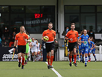 Assistant referee Tom Dillen, referee Tom Stevens and assistant referee Bryan Bijnens enter the pitch with the match ball before a female soccer game between Oud Heverlee Leuven and AA Gent Ladies on the 9 th matchday of play off 1 in the 2020 - 2021 season of Belgian Womens Super League , saturday 22 nd of May 2021  in Heverlee , Belgium . PHOTO SPORTPIX.BE | SPP | SEVIL OKTEM
