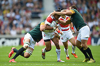 Male Sa'u of Japan is double-tackled. Rugby World Cup Pool B match between South Africa and Japan on September 19, 2015 at the Brighton Community Stadium in Brighton, England. Photo by: Patrick Khachfe / Stewart Communications