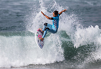 Huntington Beach, CA - Saturday August 4, 2018: Sally Fitzgibbons in action during a World Surf League (WSL) World Championship Tour (WCT) Round 3 heat at the 2018 Vans U.S. Open of Surfing on South side of the Huntington Beach pier.