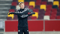 Brentford goalkeeper, Nathan Shepperd, warms up ahead of kick-off during Brentford vs Middlesbrough, Emirates FA Cup Football at the Brentford Community Stadium on 9th January 2021