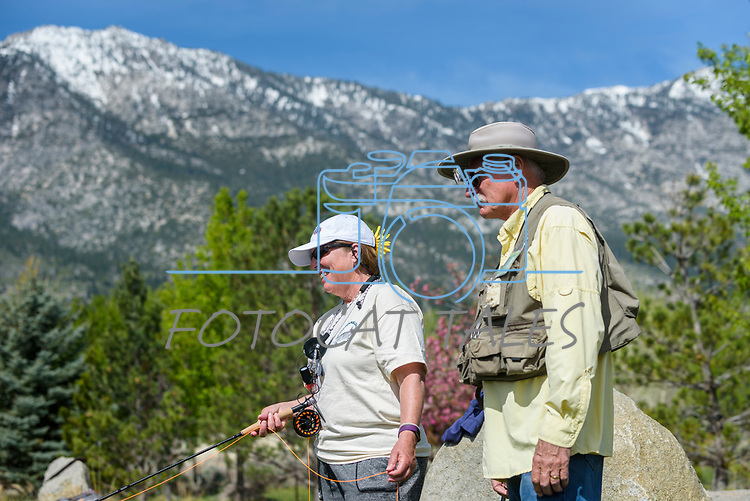 Ann Taylor learns to fly fish with her River Buddy George Liddell during the Casting for Recovery fishing clinic at Bently Ranch in Gardnerville, Nev. May 4, 2018.<br /> Photo by Candice Vivien/Nevada Momentum