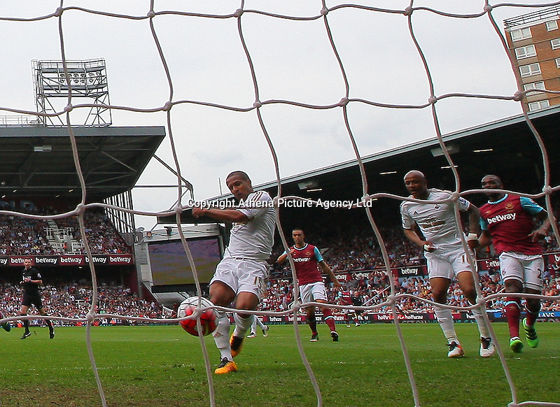 Wayne Routledge of Swansea scores the opening goal   during the Barclays Premier League match between West Ham United and Swansea City  played at Boleyn Ground , London on 7th May 2016