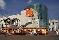 trolley, aquarium, New Orleans, Louisiana, LA, Red Riverfront Trolleys outside the Aquarium of the Americas on the riverfront in New Orleans.