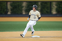 Jonathan Pryor (11) of the Wake Forest Demon Deacons pulls into second base with a double during the game against the Harvard Crimson at David F. Couch Ballpark on March 5, 2016 in Winston-Salem, North Carolina.  The Crimson defeated the Demon Deacons 6-3.  (Brian Westerholt/Four Seam Images)