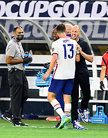 DALLAS, TX - JULY 25: USMNT Head Coach, Gregg Berhalter congratulates Matthew Hoppe #13 for his goal in the second half during a game between Jamaica and USMNT at AT&T Stadium on July 25, 2021 in Dallas, Texas.
