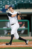 Louisville shortstop Paul Janish (17) follows through on his swing Indianapolis at Louisville Bats Field in Louisville, KY, Wednesday, August 8, 2007.