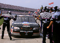 Dale Earnhardt's pit crew greets him on pit road after his win in the Die Hard 500 at Talladega , AL in April 1999. (Photo by Brian Cleary/www.bcpix.com)