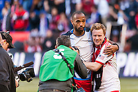 Thierry Henry (14) of the New York Red Bulls and Dax McCarty (11) hug after defeating the Philadelphia Union. The New York Red Bulls defeated the Philadelphia Union 2-1 during a Major League Soccer (MLS) match at Red Bull Arena in Harrison, NJ, on March 30, 2013.