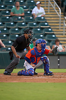 Umpire Jon-Tyler Shaw and St. Lucie Mets catcher Matt O'Neill (5) during a game against the Fort Myers Mighty Mussels on June 3, 2021 at Hammond Stadium in Fort Myers, Florida.  (Mike Janes/Four Seam Images)