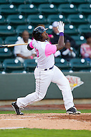 Courtney Hawkins (10) of the Winston-Salem Dash follows through on his swing against the Wilmington Blue Rocks at BB&T Ballpark on April 20, 2013 in Winston-Salem, North Carolina.  The Dash defeated the Blue Rocks 4-2 in game one of a double-header.  (Brian Westerholt/Four Seam Images)