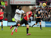 SWANSEA, WALES - FEBRUARY 21: L-R Bafetimbi Gomis of Swansea chases Daley Blind of Manchester during the Barclays Premier League match between Swansea City and Manchester United at Liberty Stadium on February 21, 2015 in Swansea, Wales.
