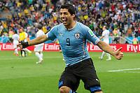 Luis Suarez of Uruguay celebrates scoring a goal after making it 1-0