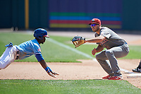 Lehigh Valley IronPigs first baseman Damek Tomscha (13) waits for a pickoff attempt throw as Jonathan Davis (1) dives back to the bag during an International League game against the Buffalo Bisons on June 9, 2019 at Sahlen Field in Buffalo, New York.  Lehigh Valley defeated Buffalo 7-6 in 11 innings.  (Mike Janes/Four Seam Images)