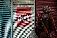 Police clash with stone throwing youth following the arrest of a separatist leader. Srinagar, Kashmir, India.  Fredrik Naumann/Felix Features