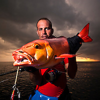 Portraits of fishermen with Snappers (Lutjianidae)