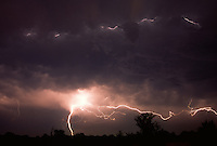 Cloud-to-cloud lightning weaves across the sky of southern Oklahoma after the passage of a complex of thunderstorms known as a Mesoscale Convective System.