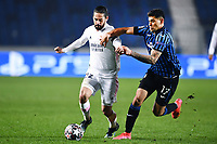 Nacho Fernandez of Real Madrid and Cristian Romero of Atalanta BC compete for the ball during the Champions League round of 16 football match between Atalanta BC and Real Madrid at Atleti azzurri d'Italia stadium in Bergamo (Italy), February, 24th, 2021. Photo Image Sport  / Insidefoto