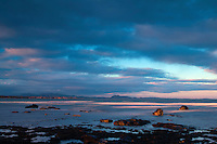 The Pentland Hills and Arthur's Seat from Longniddry Bents at dawn, East Lothian
