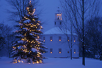 AJ5847, church, chapel, decorations, Christmas tree, holiday, village, town, winter, snow, Vermont, A large evergreen tree with white lights and candles in the windows of the Old Round Church (a 16-sided polygon) National Historical Landmark are decorated for the Christmas holiday season at night in Richmond in Chittenden County in the state of Vermont.