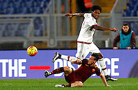 Calcio, Serie A: Roma vs Milan. Roma, stadio Olimpico, 9 gennaio 2016.<br /> AC Milan's Luiz Adriano is tackled by Roma's Alessandro Florenzi, bottom, during the Italian Serie A football match between Roma and Milan at Rome's Olympic stadium, 9 January 2016.<br /> UPDATE IMAGES PRESS/Riccardo De Luca