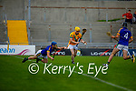 Lixnaws Declan McCarthy tries to put pressure on Daniel Collins of Kilmoyley's effort in round 2 of the County Senior hurling championship