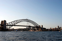 """Harbour Bridge in Sydney.Sydney ist eine Stadt in Australien und die Hauptstadt des Bundesstaates New South Wales, gegründet am 26. Januar 1788 und ist mit 3,64 Millionen Einwohnern (2006) im städtischen Gebiet (Urban Centre) die größte Stadt des australischen Kontinents. Die Stadt liegt an der Ostküste Australiens am Pazifischen Ozean..Die Sydney Harbour Bridge stellt die Hauptverbindung zwischen Sydneys Nord- und Südküste über den Hafen von Sydney (Port Jackson) dar. Neben dem berühmten Sydney Opera House wird dieses Bauwerk meist als weiteres Wahrzeichen Sydneys genannt..Sydney is the largest and most populous city in Australia and the state capital of New South Wales. Sydney is located on Australia's south-east coast of the Tasman Sea. With an approximate population of 4.5 million in the Sydney metropolitan area the city is the largest municipality in Oceania.[5] Inhabitants of Sydney are called Sydneysiders, comprising a cosmopolitan and international population. .The Sydney Harbour Bridge is a steel through arch bridge across Sydney Harbour that carries rail, vehicular and pedestrian traffic between the Sydney central business district (CBD) and the North Shore. The dramatic view of the bridge, the harbour, and the nearby Sydney Opera House is an iconic image of both Sydney and Australia. The bridge is locally nicknamed """"The Coat Hanger"""" because of its arch-based desig of people from many places around the world...Foto: Karoline Maria Keybe.01577 7729355.karoline@karoline-maria.com.Ernestistraße 12.04277 Leipzig.01577 7729355.Steuernummer: 231/238/07774..Deutsche Bank, Konto-Nr. 1272228, BLZ 86070024.Keine Umsatzsteuerpflicht nach Kleinunternehmerregelung § 19 Absatz 1 UStG"""