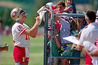 ROCKLIN, CA - Quarterback Joe Montana of the San Francisco 49ers signs autographs for the fans after practice at training camp at Sierra College in Rocklin, California in 1988. Photo by Brad Mangin