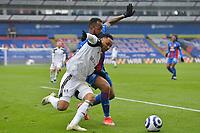 Jordan Ayew of Crystal Palace battles with Kenny Tete of Fulham during the Premier League behind closed doors match between Crystal Palace and Fulham at Selhurst Park, London, England on 28 February 2021. Photo by Vince Mignott / PRiME Media Images.