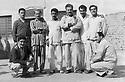 Iraq 1960 .Kurdish prisoners in jail in Baghdad: third from left, Husssein Barzinji, fourth from right, Marouf Barzinji.Irak 1960.Bagdad: Groupe de prisonniers, le 4eme a partir de gauche, Sheikh Marouf Barzinji, avec le costume raye, Hussein Barzinji