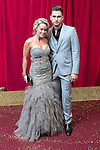 © Licensed to London News Pictures . 16/05/2015 .  The Palace Hotel , Manchester , UK . Tamara Wall and Charlie Clapham . The red carpet at the 2015 British Soap Awards , The Palace Hotel , Oxford Road , Manchester . Photo credit : Joel Goodman/LNP