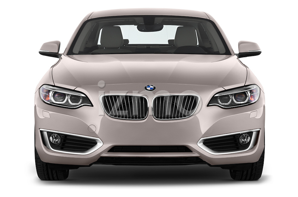 Stock Photos of a low aggressive front three quarter view of a 2014 BMW 2-Series 220d Modern Coupe.