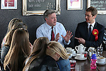 © Joel Goodman - 07973 332324 . 11/04/2015 . Bury , UK . Labour Shadow Chancellor Ed Balls (c) and James Frith (r) , Labour candidate for Bury North , at a campaign stop at Barista coffee shop at The Rock , Bury in Greater Manchester , UK . The pair met parents and discussed family finances . Photo credit : Joel Goodman