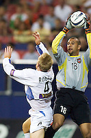 With seconds left in the second overtime MetroStars' goal keeper Tim Howard makes sure Chris Roner of the Earthquakes does not get a head on the ball. The San Jose Earthquakes and the the NY/NJ MetroStars played to a 4-4 tie on 7/02/03 at Giant's Stadium, NJ..