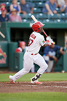Springfield Cardinals right fielder Jose Adolis Garcia (47) follows through on a swing during a game against the Corpus Christi Hooks on May 30, 2017 at Hammons Field in Springfield, Missouri.  Springfield defeated Corpus Christi 4-3.  (Mike Janes/Four Seam Images)
